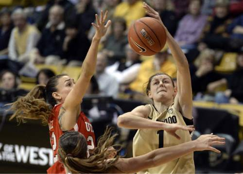 Colorado's Lexy Kresl gets fouled by Utah's Danielle Rodriguez while going for  a layup during the second half of an NCAA college basketball game Wednesday, Jan. 14, 2015, in Boulder, Colo. (AP Photo/Daily Camera, Jeremy Papasso)