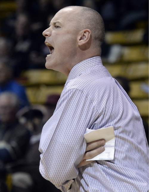 Utah coach Anthony Levrets yells to his team during the first half against Colorado in an NCAA college basketball game Wednesday, Jan. 14, 2015, in Boulder, Colo. (AP Photo/Daily Camera, Jeremy Papasso)