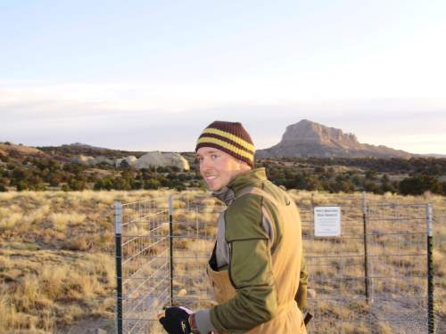 Courtesy  |  Melissa Ranglack, USU  In southeastern Utahís Henry Mountains, Utah State University ecologist Dustin Ranglack stands near an exclosure used to study foraging behavior of bison and other herbivores.