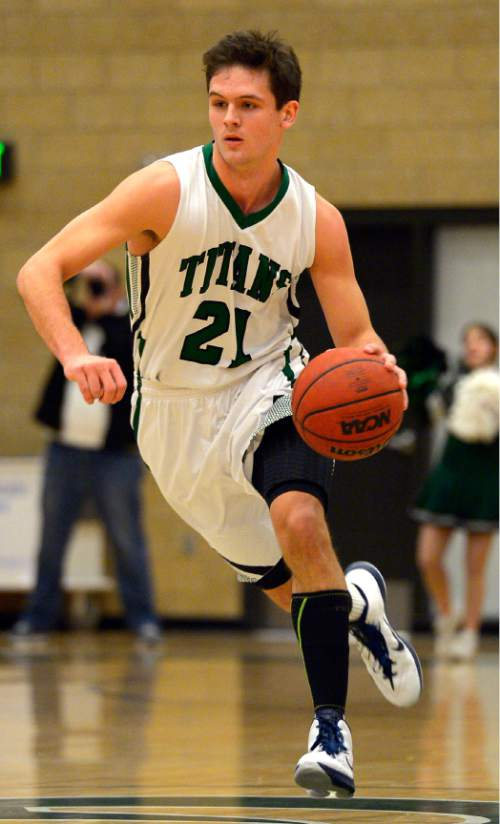 Leah Hogsten  |  The Salt Lake Tribune Olympus' Jake Lindsey. Timpanogos High School's boys basketball team defeated Olympus High School 49-42, Tuesday, January 20, 2015 at Olympus.
