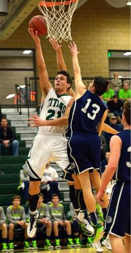 Leah Hogsten  |  The Salt Lake Tribune Olympus' Jake Lindsey battles Timpanogos' Chase Pickett. Timpanogos High School's boys basketball team defeated Olympus High School 49-42, Tuesday, January 20, 2015 at Olympus.