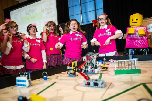 Chris Detrick  |  The Salt Lake Tribune Electro Cuties team members, of Alpine, cheer as they compete in the Fifth Annual Utah FIRST LEGO League State Championship at the University of Utah Union Building Saturday January 31, 2015.