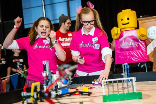 Chris Detrick  |  The Salt Lake Tribune Electro Cuties team members Hadley Peay, 13, left, and Morgan Topham, 13, of Alpine, compete in the Fifth Annual Utah FIRST LEGO League State Championship at the University of Utah Union Building Saturday January 31, 2015.