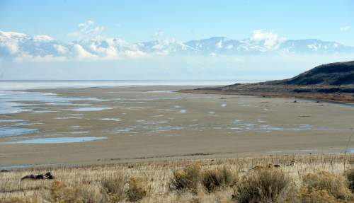 Al Hartmann  |  The Salt Lake Tribune A view from the shore of Antelope Island looking east toward the Wasatch Mountains shows mudflats that are usually submerged by water of the Great Salt Lake Wednesday Jan. 21, 2015.