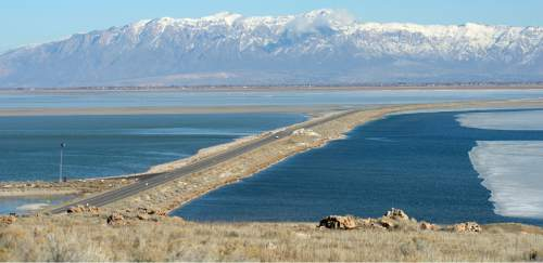 Al Hartmann  |  The Salt Lake Tribune A view of the causeway from Antelope Island looking east toward Syracuse Wednesday Jan. 21, 2015. During the mid-1980s the causeway was covered by the rising Great Salt Lake. Now the lake is approaching near-record low levels.
