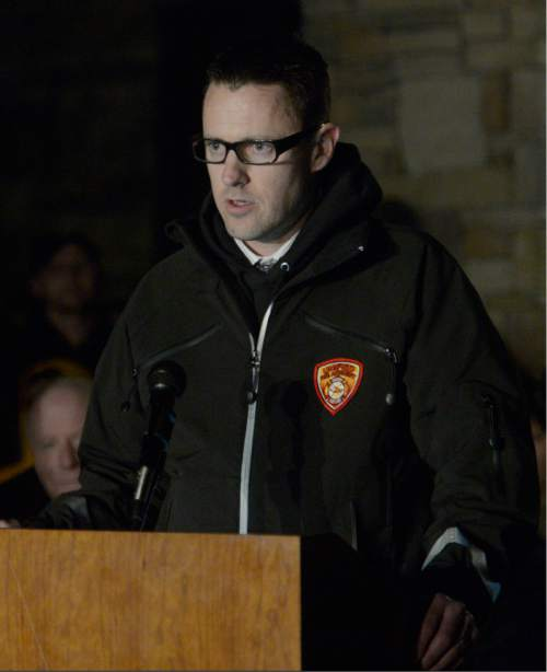 Rick Egan  | The Salt Lake Tribune   Eagle Mountain Mayor Christopher Pengra says a few words at the vigil for slain Utah County Sheriff's Sgt. Cory Wride and wounded Deputy Greg Sherwood, in Eagle Mountain, Utah, Monday, February 3, 2014.