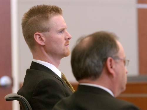 Dell Schanze, known for his Totally Awesome Computers business, is shown in court, Thursday, May 11, 2006, in West Jordan, Utah, during his trial on charges of brandishing a weapon at neighbors angry that he sped through their neighborhood. A jury found Schanze not guilty on those charges Thursday, but found him guilty of lying to police about the incident. (AP Photo/Mark DiOrio, Pool)