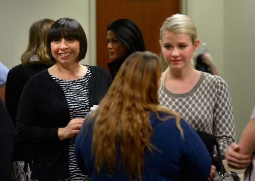 Scott Sommerdorf   |  The Salt Lake Tribune As Elizabeth Smart, right, speaks with others who attended the committee meeting where HB286 - Child Sexual Abuse Prevention - was heard in committee, the sponsor of the bill, Rep. Angela Romero, D-Salt Lake speaks with attendees, Wednesday, Feb. 19, 2014.