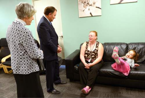 Leah Hogsten  |  The Salt Lake Tribune l-r Pamela Atkinson and Gov. Gary Herbert talk with Crystal Spencer, a formerly homeless mother who received critical care and support that was funded, in part, by the Pamela Atkinson Homeless Trust Fund. The Volunteers of America Adult Detoxification Center is one of the many service organizations in Utah that receive funding through the and helps those in need of drug and alcohol recovery. Utahns have the opportunity to support the trust fund through donations on their tax form. All donations to the fund go directly to service organizations that provide vital services to individuals and families experiencing homelessness.
