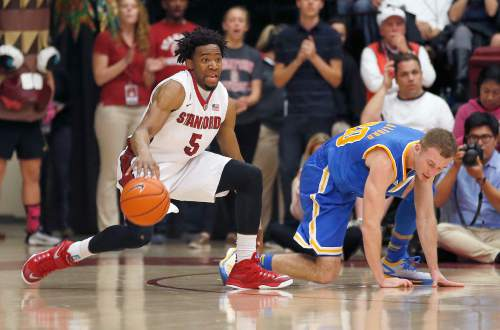 Stanford guard Chasson Randle (5) steals the ball from UCLA guard Bryce Alford, right, during the second half of an NCAA college basketball game Thursday, Feb. 5, 2015, in Stanford, Calif. UCLA won 69-67. (AP Photo/Tony Avelar)