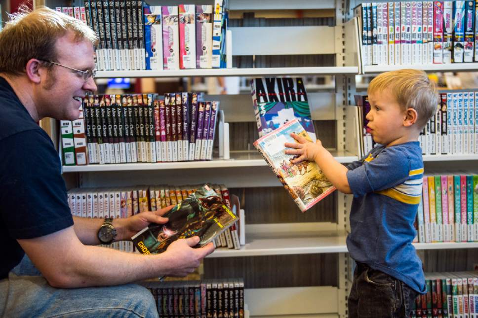 Chris Detrick  |  The Salt Lake Tribune Peirce Frandsen, 2, helps his dad Jordan Frandsen pick out books during the grand opening of the Glendale Branch library Saturday February 7, 2015.   The branch features nearly 20,000 square feet of space, making it the largest City Library branch, and offers 40,000 items for circulation. The branch also includes a large meeting facility, a designated teen space, and a floor plan that offers open views across the building.