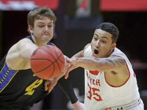 Utah forward Kyle Kuzma (35) steals the ball from South Dakota State forward Ian Theisen (42) in the second half during an NCAA college basketball game Tuesday, Dec. 23, 2014, in Salt Lake City. Utah won 80-66. (AP Photo/Rick Bowmer)