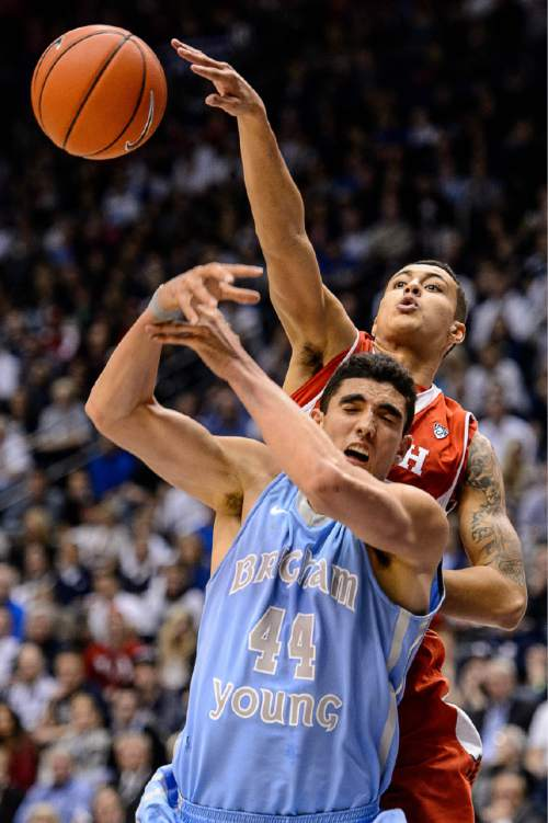 Trent Nelson  |  The Salt Lake Tribune Utah Utes forward Kyle Kuzma (35) defends Brigham Young Cougars center Corbin Kaufusi (44) as BYU hosts Utah, college basketball at the Marriott Center in Provo, Wednesday December 10, 2014.