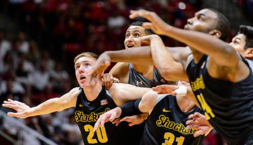 Trent Nelson  |  The Salt Lake Tribune Utah Utes forward Kyle Kuzma (35, center) gets boxed out on a free throw as the University of Utah Utes host the Wichita State Shockers, college basketball at the Huntsman Center in Salt Lake City, Wednesday December 3, 2014. Wichita State Shockers center Rauno Nurger (20) at left.