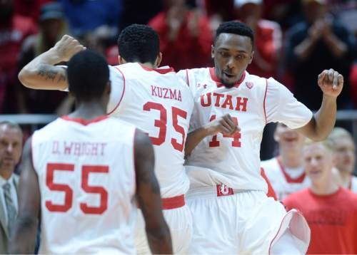 Steve Griffin  |  The Salt Lake Tribune   Utah Utes forward Kyle Kuzma (35) and Utah Utes guard/forward Dakarai Tucker (14) leap up and pump together after Kuzma nailed a three-pointer causing Colorado to call a time-out during second half action in the Utah versus Colorado men's basketball game at the Huntsman Center in Salt Lake City, Wednesday, January 7, 2015.
