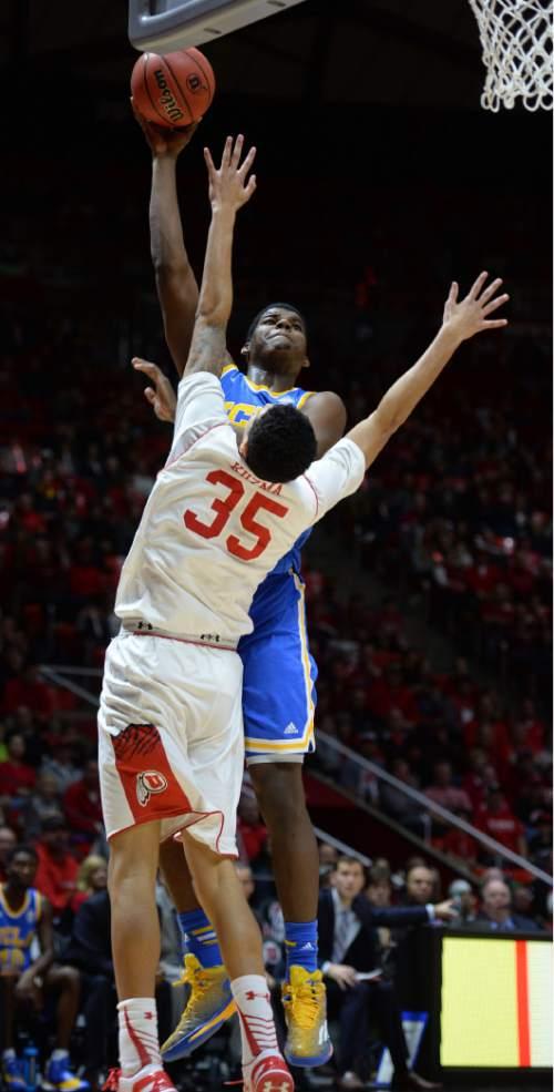 Steve Griffin  |  The Salt Lake Tribune   UCLA Bruins forward Tony Parker (23) shoots over Utah Utes forward Kyle Kuzma (35) during second half action in the Utah versus UCLA men's basketball game at the Huntsman Center in Salt Lake City, Sunday, January 4, 2015.