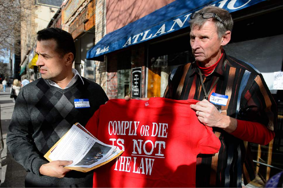 Trent Nelson  |  The Salt Lake Tribune Michael Bell, left, whose son was shot by police in Wisconsin in 2004, is given a T-shirt by Scott Simons at a gathering put on by Melissa Kennedy, the mother of Danielle Willard, at Atlantic Cafe in Salt Lake City, Saturday February 7, 2015.