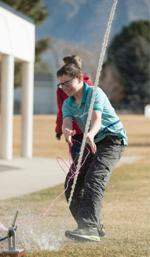 Rick Egan  |  The Salt Lake Tribune  Anson Wood launches a rocket during his science class at Lakeridge Jr. High, Thursday, February 5, 2015