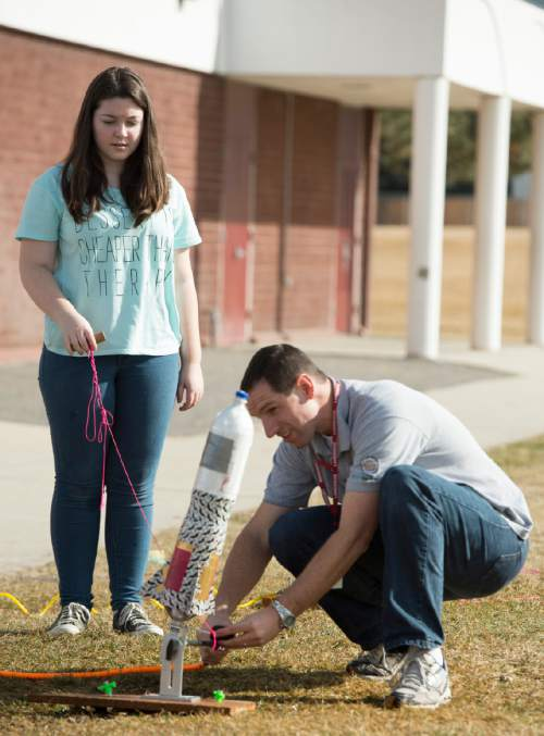 Rick Egan  |  The Salt Lake Tribune  Lakeridge Jr. High eighth-grade science teacher Josh Stowers prepares Bridget Flemming's rocket to be launched during his science class, Thursday, February 5, 2015