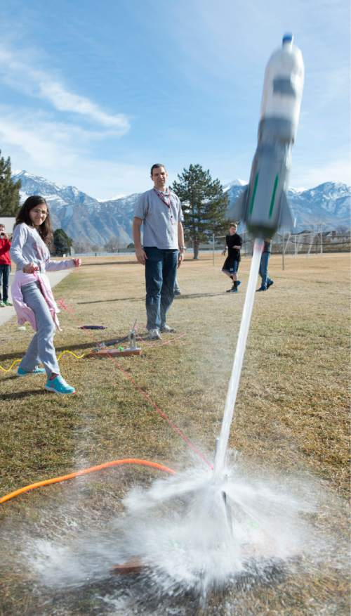 Rick Egan  |  The Salt Lake Tribune  Mckenna Dominguez launches a rocket during her eighth-grade science class at Lakeridge Jr. High, Thursday, February 5, 2015