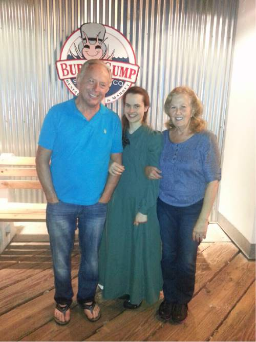 |  Courtesy Ron and Geri Rohbock  Ron Rohbock poses in October 2014 with his daughter Sherilyn, center, and his wife Geri at the Bubba Gump Shrimp Co. in Santa Monica, Calif. Sherilyn, who spent 12 years away from her father while being raised among the FLDS, enjoyed shrimp, her father said.