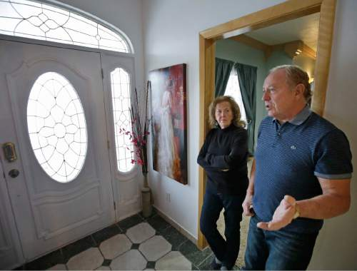 "In this Dec. 16, 2014 photo, Ron Rohbock and his wife, Geri, stand in their home in Hildale, Utah. Ron Rohbock, a former member of the Fundamentalist Church of Jesus Christ of Latter-Day Saints, or FLDS, was kicked out in 2002. After he was ousted, he had to file bankruptcy and contemplated suicide. ""I continually blamed myself and thought I was going to go to hell because they tell you that's exactly what's going to happen,"" Rohbock said. ""But I can tell you: This is hell. It can't get worse this. If this is heaven, you don't want anything to do with it."" (AP Photo/Rick Bowmer)"