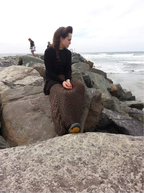 |  Courtesy Ron and Geri Rohbock  Sherilyn Rohbock, 17, sits along the La Jolla beach in San Diego, Calif., in October 2014. Rohbock grew up in the FLDS but quit wearing a so-called prairie dress and put on more conventional clothing after a few days with her father.