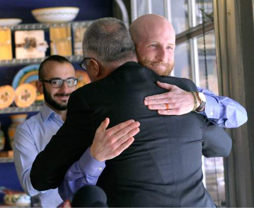 "Al Hartmann  |  The Salt Lake Tribune Salt Lake County District Attorney Sim Gill hugs Derek Kitchen, right, as KItchen announces his candidacy for Salt Lake City's District 4 Council Seat Tuesday Feb. 10, 2015, at Caputo's Market and Deli across from Pioneer Park. In 2013, Kitchen and his partner, Moudi Sbeity, along with two other gay couples, won their case (Kitchen v. Herbert) in federal court overturning Utah's same-sex marriage ban. It made Utah the 18th state to permit same-sex couples to legally marry. Kitchen is a South Jordan native and the owner and operator of a small business in Salt Lake City. He launched Laziz Foods in 2012. As a resident and business owner, Kitchen said he has a ""unique and valuable"" understanding of the area."