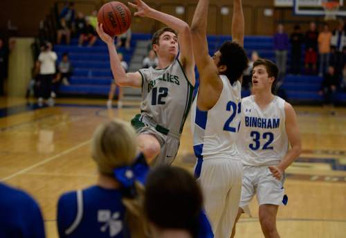 Scott Sommerdorf   |  The Salt Lake Tribune Copper Hills' Stockton Shorts challenges Bingham's Yoeli Childs as he drives to the hoop during first-half play. Behind Shorts' clutch free throws down the stretch, Copper Hills upset Bingham on the road, Friday, February 6, 2015.