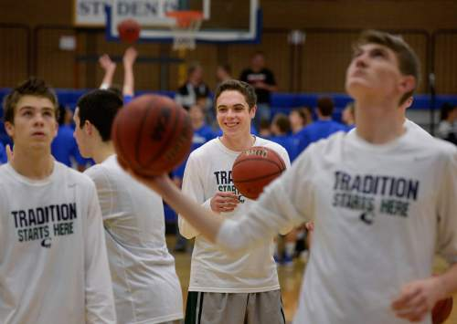 Scott Sommerdorf   |  The Salt Lake Tribune Copper Hills' Stockton Shorts, center, smiles as he warms up with teammates prior to the match at Bingham. Behind Shorts' clutch free throws down the stretch, Copper Hills upset Bingham on the road, Friday, February 6, 2015.