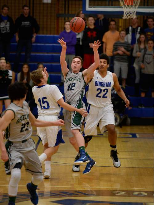 Scott Sommerdorf   |  The Salt Lake Tribune Copper Hills' Stockton Shorts makes an outlet pass to teammate Preston Sanchez during first-half play. Behind Shorts' clutch free throws down the stretch, Copper Hills upset Bingham on the road, Friday, February 6, 2015.