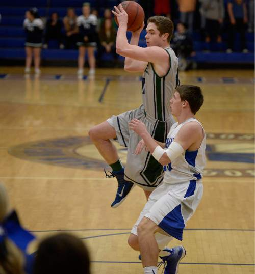 Scott Sommerdorf   |  The Salt Lake Tribune Copper Hills' Stockton Shorts drives and then dishes off a pass during first-half play versus Bingham. Behind Shorts' clutch free throws down the stretch, Copper Hills upset Bingham on the road, Friday, February 6, 2015.