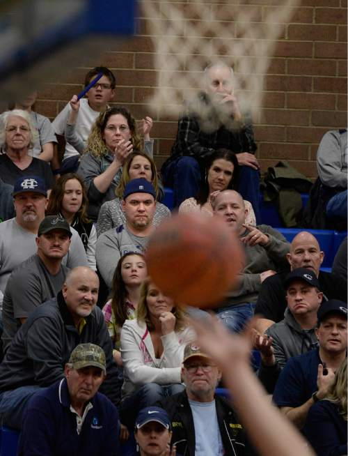 Scott Sommerdorf   |  The Salt Lake Tribune Stockton Shorts' parents watch as the game is underway during first-half play. Mrs. Shorts can be seen just to the lower left of the net, and his father is just to the upper left of the ball. Behind their son's clutch free throws down the stretch, Copper Hills upset Bingham on the road, Friday, February 6, 2015.