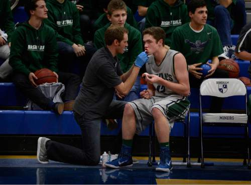 Scott Sommerdorf   |  The Salt Lake Tribune Stockton Shorts spent time on the bench while the trainer cared for his cut lip. He got in the game late, and sank key free throws to seal the win over Bingham. Copper Hills beat Bingham 52-48 on the road in South Jordan, Friday, February 6, 2015.