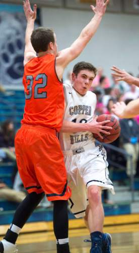 Steve Griffin  |  The Salt Lake Tribune  Copper Hills'  guard Stockton Shorts drives into the lane during game against Brighton at Copper Hills High School in West Jordan, Utah Tuesday, February 3, 2015.