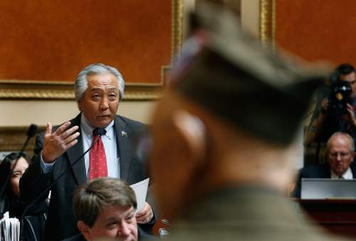 Scott Sommerdorf  |  The Salt Lake Tribune              Rep. Curt Oda, R, Clearfield reads the text of HCR5 honoring Nisei veterans of the 100th Infanty Battalion and the 442nd Regimental Combat Team in the Utah House of Representatives, Monday February 13, 2012.