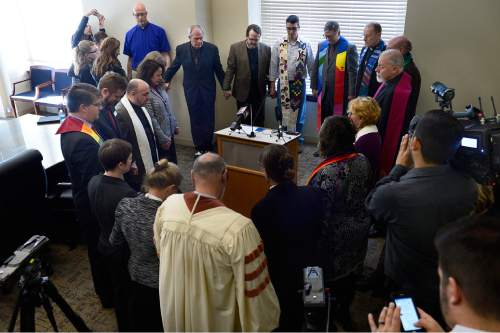 Scott Sommerdorf   |  The Salt Lake Tribune A group of leaders from a range of religious faiths held hands in prayer after a press conference where they urged the legislature to pass SB 100 - Antidiscrimination Amendments, Thursday, February 12, 2015.