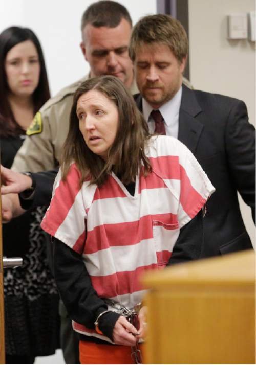 Megan Huntsman appears in court in Provo, Utah on Thursday, Feb. 12, 2015. The mother accused of killing six of her newborn babies and storing their bodies in her garage pleaded guilty to murder. Huntsman, 39, faces up to life in prison on the charges, with sentencing scheduled for April 20. Authorities say a seventh baby found in her garage was stillborn. (AP Photo/Rick Bowmer, Pool)