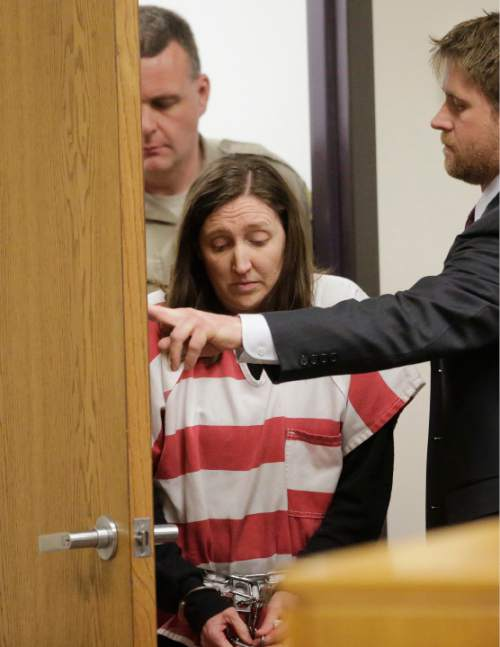 Megan Huntsman appears in court  Thursday, Feb. 12, 2015, in Provo, Utah. Huntsman a Utah mother accused of killing six of her newborn babies and storing their bodies in her garage pleaded guilty to murder. Huntsman, 39, faces up to life in prison on the charges. She will be sentenced April 20. (AP Photo/Rick Bowmer, Pool)