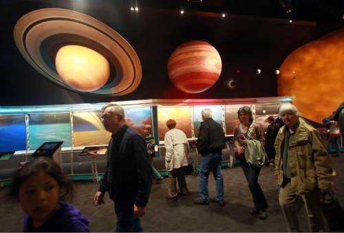 Kim Raff     The Salt Lake Tribune Visitors view The Solar System exhibit at the Clark Planetarium in Salt Lake City on March 25, 2013. The planetarium is celebrating it's 10th anniversary.
