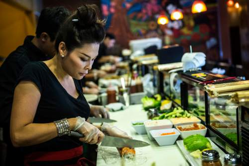 Chris Detrick  |  The Salt Lake Tribune Mai Nguyen makes sushi at Sapa Sushi Bar & Grill in Salt Lake City on Wednesday, Aug. 13, 2014.  Nguyen was recently named Woman Business Owner of the Year by the Salt Lake chapter of the National Association of Women Business Owners. Nguyen and her family own four Salt Lake County restaurants: Sapa Sushi Bar, Bucket O'Crawfish, Fat Fish and Noodle and Chop Stick.