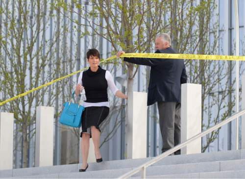 Steve Griffin     The Salt Lake Tribune   Authorities let citizens out of Salt Lake City's new federal courthouse after a defendant was shot inside Monday morning in Salt Lake City, Utah Monday, April 21, 2014.