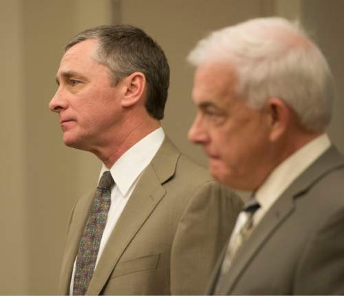 Steve Griffin  |  The Salt Lake Tribune   James Wesley Robinson,  left, and attorney Ed Brass listen to Judge James Blanch as he talks during sentencing of Robinson for his roll in a clandestine drug operation that he -- along with his two sons Zachary Ryan Robinson and Alexander Jordan Robinson - ran from the family's Sugar House home. All three of the men were sentenced in Blanch's courtroom at the Matheson Courthouse in Salt Lake City, Friday, February 13, 2015.