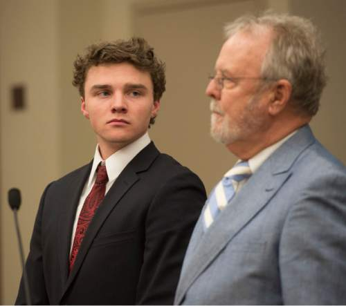 Steve Griffin  |  The Salt Lake Tribune  Alexander Jordan Robinson, left, listens to his attorney, Loni DeLand, during his sentencing for his roll in a clandestine drug operation that he ó along with his brother Zachary Ryan Robinson and his father James Wesley Robinson - ran from the familyís Sugar House home. All three of the men were sentenced in Judge James Blanch's court at the Matheson Courthouse in Salt Lake City, Friday, February 13, 2015.