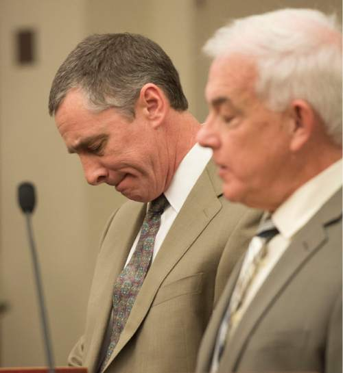 Steve Griffin  |  The Salt Lake Tribune   James Wesley Robinson,  left, and attorney Ed Brass listen to Judge James Blanch as he talks during sentencing of Robinson for his roll in a clandestine drug operation that he ó along with his two sons Zachary Ryan Robinson and Alexander Jordan Robinson - ran from the familyís Sugar House home. All three of the men were sentenced in Blanch's courtroom at the Matheson Courthouse in Salt Lake City, Friday, February 13, 2015.