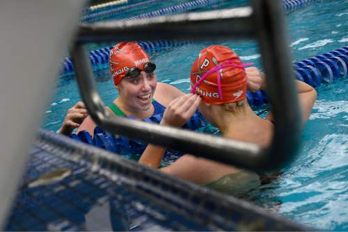 Scott Sommerdorf   |  The Salt Lake Tribune Park City's Mara Selznick, left, and Katie Hale celebrate their 1-2 finish in the Women's 100 yard backstroke at the 3A Utah State Swimming Championships, Saturday, February 14, 2015. Hale won with a time of 58:45, and Selznick was second at 58:90.