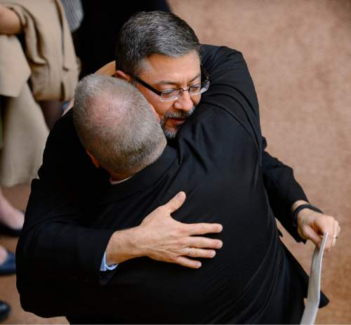 Trent Nelson  |  The Salt Lake Tribune Constandinos Himonas is embraced by Sen. Stephen Urquhart, R-St. George, following his confirmation by the Senate during the legislative session at the State Captiol Building in Salt Lake City, Friday February 13, 2015.