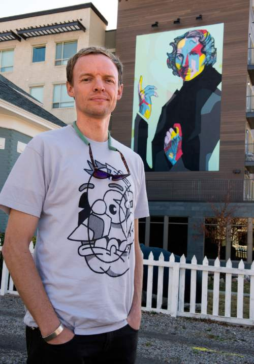 Rick Egan  |  The Salt Lake Tribune  Artist Chuck Landvatter in front the mural at the new North Sixth apartment complex, Wednesday, Feb. 11, 2015. The mural features a likeness of Thelma McDonald, a fixture in the neighborhood, taken from a family photo.