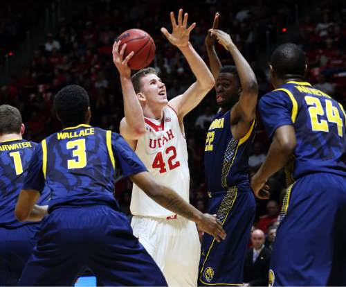 Utah forward Jakob Poeltl (42) drives the basket past California forward Dwight Tarwater (1),Tyrone Wallace (3), Kingsley Okoroh and Jordan Mathews (24) during the second half of an NCAA college basketball game Sunday, Feb. 15, 2015, in Salt Lake City. Utah won 76-61. (AP Photo/Kim Raff)