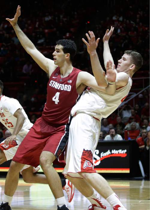 Utah forward Jakob Poeltl, right, and Stanford center Stefan Nastic (4) battle for position in the first half during an NCAA college basketball game Thursday, Feb. 12, 2015, in Salt Lake City. (AP Photo/Rick Bowmer)